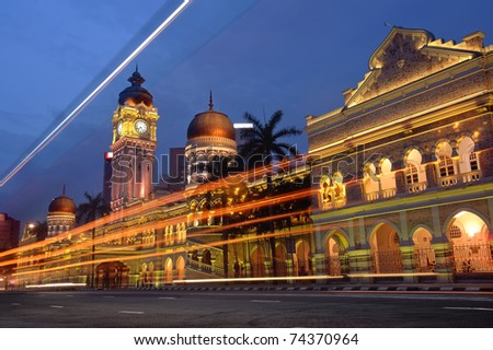 Cityscape of night with famous building and cars motion blurred in Kuala Lumpur, Malaysia, Asia. - stock photo
