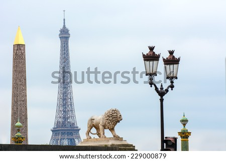 Cityscape of Paris including the Luxor Obelisk, Eiffel Tower and Colonne Rostrate in Paris, France. - stock photo