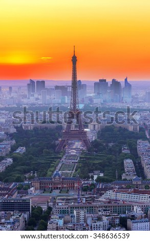 cityscape of Paris with Eiffel Tower  from above in orange sunset sunlight, France