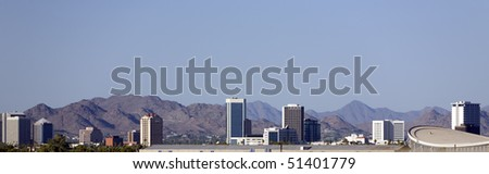 Cityscape of Phoenix Downtown against North-East Camelback Mountain Range - stock photo