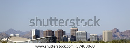 Cityscape of Phoenix Downtown against North-East Camelback Mountain Range