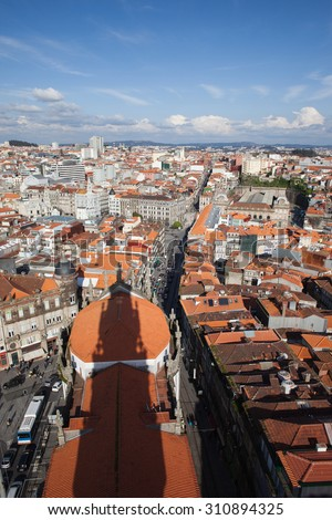Cityscape of Porto in Portugal, view from above, shadow of Clerigos Church Tower on rooftop. - stock photo