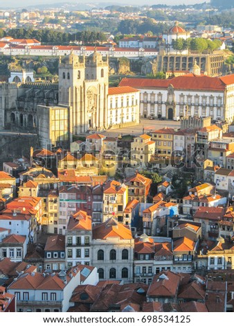 Cityscape of Porto, Portugal, viewed from the Torre dos Clerigos - buildings, traditional houses and landmarks in sunset light
