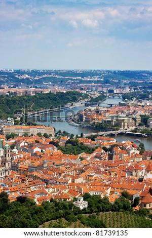 Cityscape of Prague in summer. River, bridges - stock photo