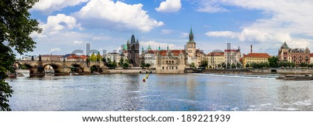 Cityscape of Prague. Panoramic view of Karlov or charles bridge and river Vltava in Prague in summer - stock photo