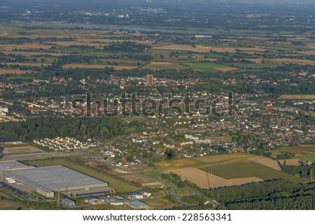 CItyscape of Rheinberg with industrial area and  agriculture in the Lower Rhine Region of Germany - Rheinberg, North Rhine-Westfalia, Germany, Europe - stock photo