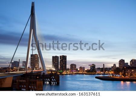 Cityscape of Rotterdam in the evening, on the left Erasmus Bridge (Dutch: Erasmusbrug), city center, South Holland, the Netherlands. - stock photo