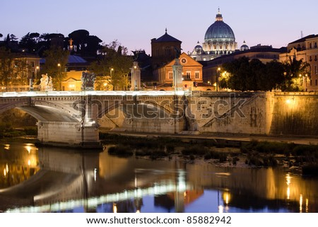 Cityscape of Saint Peter's basilica Vatican Rome Italy and Vittorio Emanuele bridge on Tiber bank in twilight