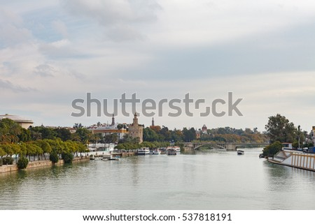 Cityscape of Seville with Golden tower (Torre del Oro) along the Guadalquivir river. Andalusia, Spain