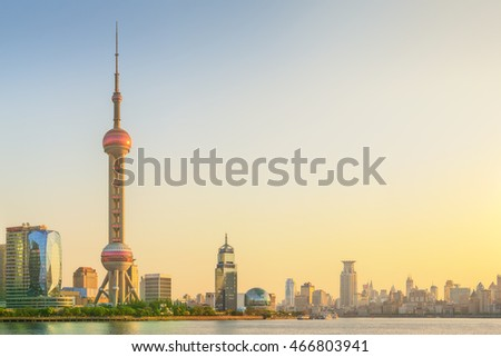 Cityscape of Shanghai and Huangpu River on sunset, beautiful reflection on skyscrapers, China.