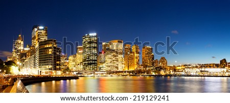 cityscape of sydney at nightfall