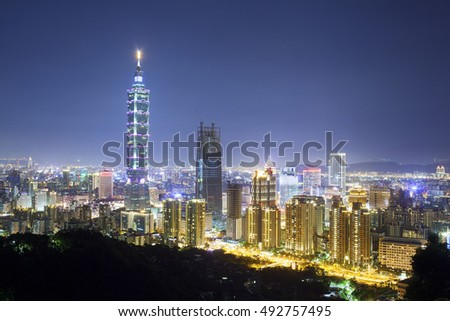 Cityscape of taipei viewpoint at night with one new building under construction nearby . one of the best Landmark destinations in Taiwan