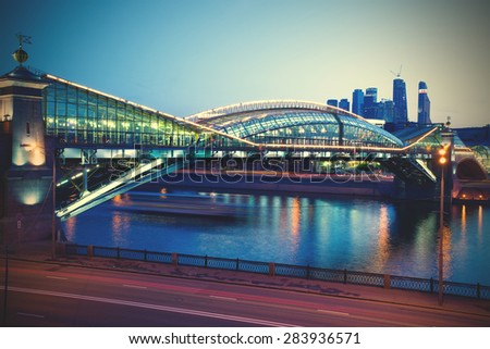 cityscape of the Moscow city with Bogdan Hmelnitsky covered bridge at spring evening. instagram image filter retro style - stock photo