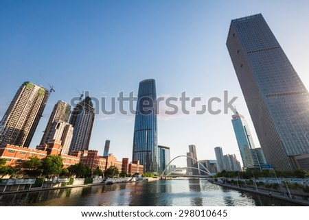 cityscape of tianjin central business district at dusk - stock photo