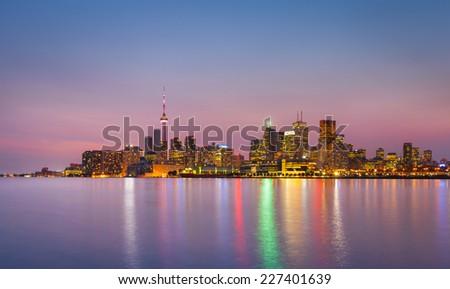 Cityscape of Toronto over Ontario Lake at dusk - stock photo
