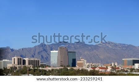 Cityscape of Tucson downtown against mountain range, Arizona - stock photo