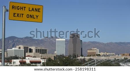 Cityscape of Tucson downtown and Santa Catalina mountain range near Interstate-10 Exit to downtown, Arizona - stock photo
