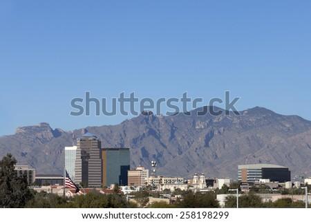 Cityscape of Tucson downtown backed up by Santa Catalina mountain range, Arizona - stock photo