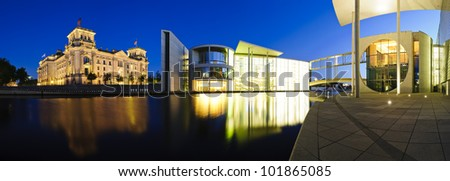 cityscape panorama with german government buildings and reichstag in berlin, germany, at night - stock photo