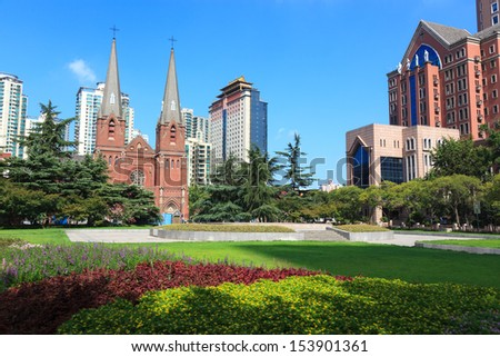 Cityscape - the square of St. Ignatius Cathedral, also referred to as Xujiahui Cathedral ,one of most famous Catholic cathedral in shanghai,China - stock photo