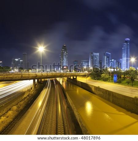 Cityscape traffic at night - stock photo