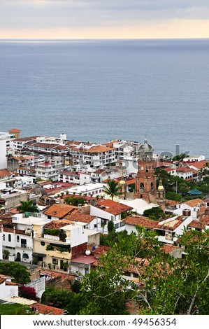 Cityscape view from above with church and Pacific ocean in Puerto Vallarta, Mexico - stock photo