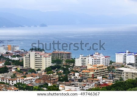 Cityscape view from above with Pacific ocean in Puerto Vallarta, Mexico - stock photo