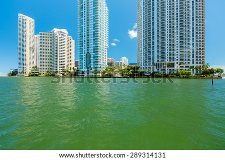 Cityscape view of downtown Miami along the Miami River inlet with Brickell Key in the background. - stock photo