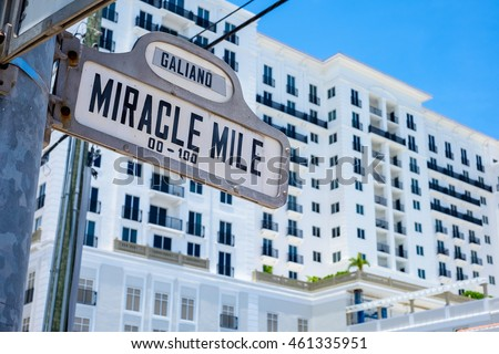 Cityscape view of the intersection of Miracle Mile and Galiano Street in Coral Gables, Florida.