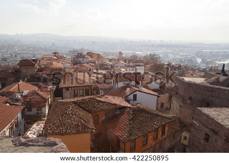 Cityscape view with old small houses from historical Ankara Tower on cloudy sky background.