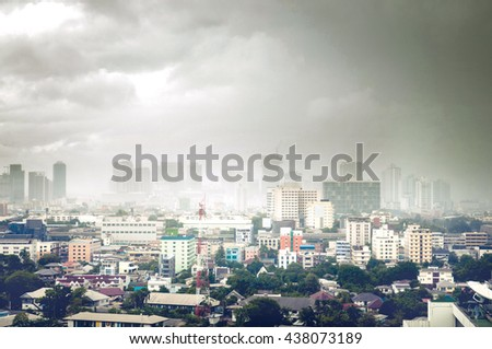 Cityscape views with a storming rain on a cloudy day. - stock photo