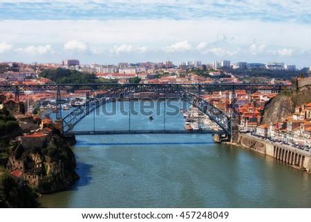 Cityscape with Dom Luis I Bridge over Douro River between Porto and Vila Nova de Gaia in Portugal - stock photo