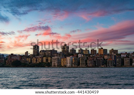 Cityscape with dramatic colorful evening sky on the background. Modern buildings of Kirribilli suburb of North Sydney, Australia. Urban sunset landscape with space for text - stock photo