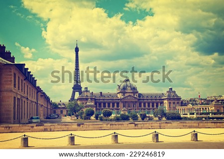 Cityscape with Eiffel Tower in Paris France. Vintage toned photo.  - stock photo