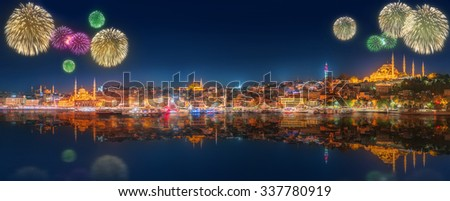 Cityscape with Galata Tower, Golden Horn and ferry wirh beautiful fireworks in Istanbul, Turkey