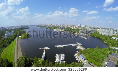 Cityscape with many yachts on moorage in city river bay at summer sunny day. Aerial view videoframe - stock photo
