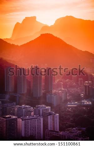 Cityscape with mountain range in the background at dusk, Rio De Janeiro, Brazil - stock photo