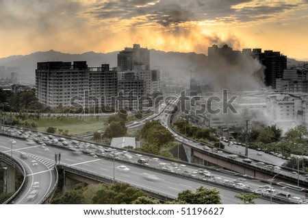 Cityscape with on fire buildings and smoke in modern city. - stock photo