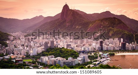 Cityscape with the Christ The Redeemer statue in the background, Corcovado, Rio de Janeiro, Brazil - stock photo