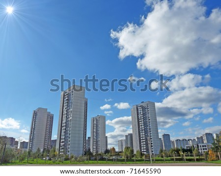 Cityscape with the sun. Summer Day