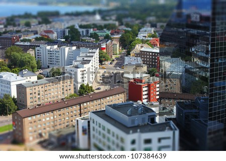 Cityscape with traffic with tilt-shift effect - stock photo