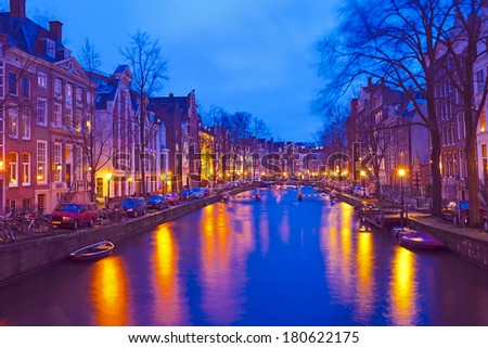 Cityscenic from Amsterdam in the Netherlands by night - stock photo