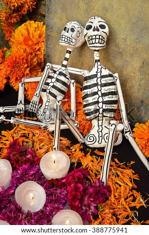 CIUDAD DE MEXICO, CDMX / MEXICO- OCTOBER 31 2015: Traditional day of the dead altar with skeletons and candles. Festivity celebrated throughout Mexico in October 31, November 1 and November 2 - stock photo