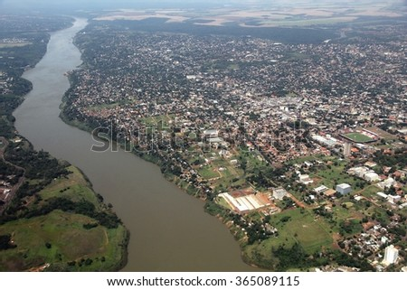Ciudad del Este, Paraguay - aerial view with river Parana. - stock photo