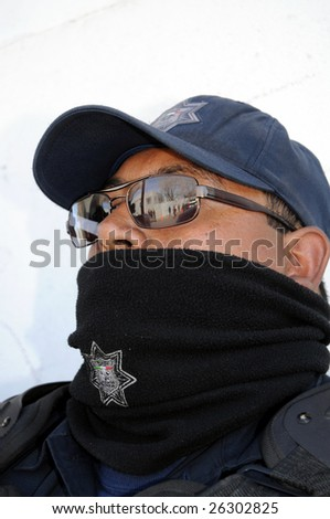 CIUDAD JUAREZ, MEXICO - FEB 27: A federal policeman waits for orders on February 27, 2009, in the violence-ridden border city of Ciudad Juarez, Mexico. - stock photo