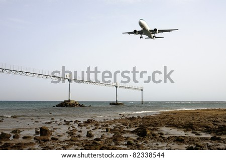 Civil aircraft taking off at an airfield in Lanzarote - stock photo