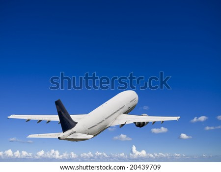 Civil airliner over a deep blue sky with some cloud - stock photo