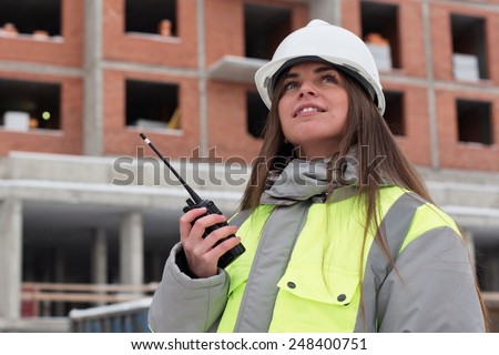 Civil Engineer at at construction site is inspecting ongoing production - stock photo