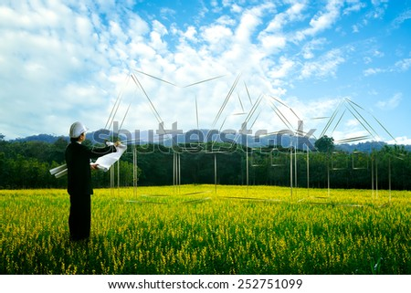 Civil engineer planing at empty landscape with house building drawing in background - stock photo