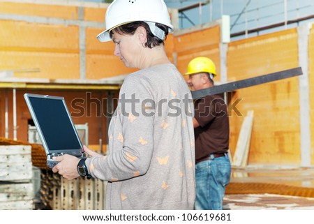 Civil engineer with a laptop on site - stock photo